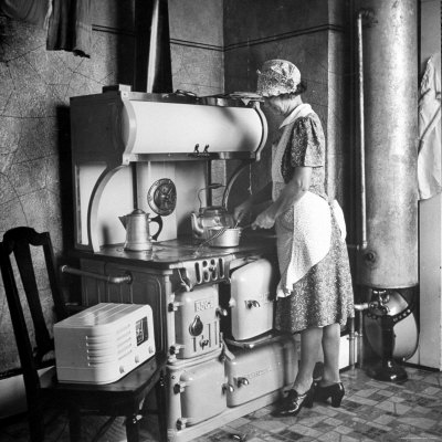 Fashioned Names Female on 594354 Woman Cooking On Old Fashioned Stove Posters
